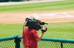 Camera Man. Man holding camera at game stock photos