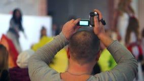 Camera man concert crowd stock video