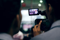 Camera man covering event professional beauty 2014 Stock Image