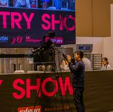 Camera man filming pastry show. Seoul, South Korea, January, 19, 2018: Camera man filming pastry show at the Seoul Salon of Chocolate exhibition at COEX Mall Royalty Free Stock Photos