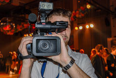 Camera man front lens ball dancing college night club young Stock Photos