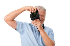 Camera man hobby. Mature man using digital camera photography hobby isolated on white background Royalty Free Stock Images
