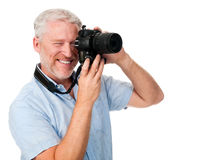 Camera man hobby. Mature man using digital camera photography hobby isolated on white background Stock Photo