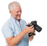 Camera man hobby. Mature man using digital camera photography hobby isolated on white background Stock Image