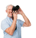 Camera man hobby. Mature man using digital camera photography hobby isolated on white background Royalty Free Stock Image