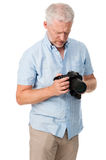 Camera man hobby. Mature man using digital camera photography hobby isolated on white background Royalty Free Stock Photography