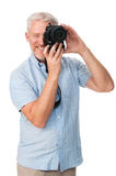 Camera man hobby. Mature man using digital camera photography hobby isolated on white background Royalty Free Stock Photos