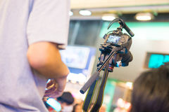 Camera man is recording video in town. Camera Royalty Free Stock Image