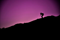 Camera man. Silhouette of a camera man royalty free stock image