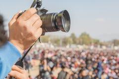 Camera Man Taking Photos with Digital DSLR Camera. At the Concert in Kathmandu Nepal stock images