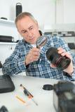 Camera man using lens. Camera man is using lens Royalty Free Stock Images