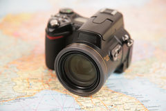 Camera on map Stock Photos