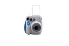 Camera. Mini Polaroid camera with print Stock Photo