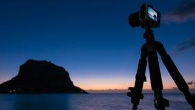 Camera and Monemvasia island at sunrise Stock Image