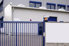 Camera monitored factory entrance