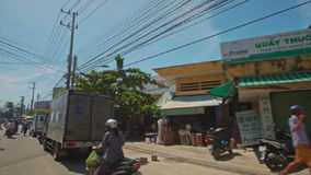 Camera on Motorbike Moves along Palms Trees in Blossom. NHA TRANG, KHANH HOA/VIETNAM - JUNE 13 2016: Camera on motorbike films village road between blooming stock footage
