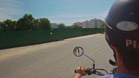 Camera on Motorbike Moves along Palms Trees in Blossom stock video