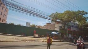 Camera on Motorbike Moves along Palms Trees in Blossom. NHA TRANG, KHANH HOA/VIETNAM - JUNE 13 2016: Camera on motorbike films village road between blooming stock video footage