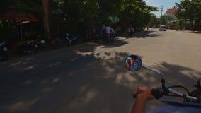 Camera on Motorbike Moves along Palms Trees in Blossom. NHA TRANG, KHANH HOA/VIETNAM - JUNE 13 2016: Camera on motorbike films village road between blooming stock video