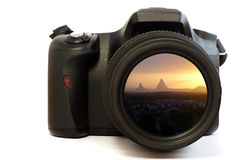 Camera mountain sunset. A photo of a sunset looking toward mountains displayed in the camera lens Royalty Free Stock Photo