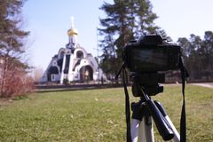 Camera mounted on a tripod. Digital camera for taking photos. Details and close-up. Details and close-up stock photos
