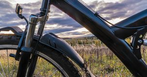 Camera movement along the bicycle against the setting sun, beautiful landscape, time lapse, hyperlapse.  stock video footage