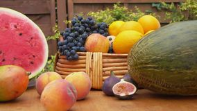 Camera movement along a still-life of fresh fruit. On a wooden table stock video