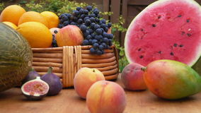 Camera movement along a still-life of fresh fruit. On a wooden table stock footage
