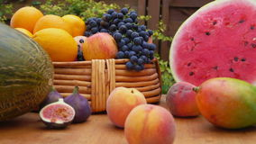 Camera movement along a still-life of fresh fruit. On a wooden table stock video footage