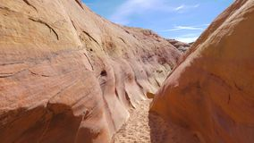 Camera Movement On A Dry Gorge With Smooth And Wavy Rocks Of The Red Canyon 4K. Movement of the camera along the dried stone gorge with smooth and wavy on the stock footage