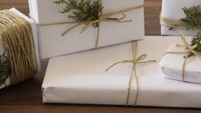 Camera moves along an elegant white handcraft gift boxes on the wooden floor stock footage