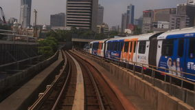 Camera moves along KL Metro Rails among Skyscrapers. KUALA LUMPUR/Malaysia - MARCH 21 2016: Camera moves along KL Metro rails among city open space with stock video