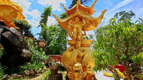 Camera Moves along Path to Gold Buddha Statue in Park in Vietnam stock footage