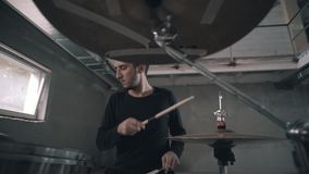 The camera moves around the drummer as he plays his part. Dynamic camera. stock video
