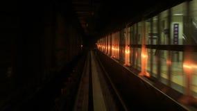 Camera Moves Backward along Metro Rails in Dark Tunnel. KUALA LUMPUR/Malaysia - MARCH 21 2016: Camera moves backward along KL Metro rails through dark tunnel stock video