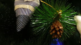 Camera moves between Christmas tree branches stock footage