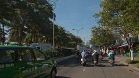 Camera Moves through City Traffic Jam in Vietnam. NHA TRANG, KHANH HOA/VIETNAM - JUNE 01 2016: Camera moves through city traffic jam among scooters large buses stock video footage