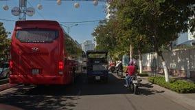 Camera Moves through City Traffic Jam in Vietnam. NHA TRANG, KHANH HOA/VIETNAM - JUNE 01 2016: Camera moves through city traffic jam among scooters large buses stock footage