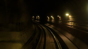 Camera Moves Forward along Metro Rails in Dark Tunnel. KUALA LUMPUR/Malaysia - MARCH 21 2016: Camera moves forward along KL Metro rails through dark tunnel with stock video footage