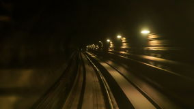 Camera Moves Forward along Metro Rails in Dark Tunnel. KUALA LUMPUR/Malaysia - MARCH 21 2016: Camera moves forward along KL Metro rails through dark tunnel with stock footage