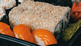 Camera moves left from stylish fresh sushi set with various kinds of sushi rolls, close up. Camera moves left from sStylish fresh sushi set with various kinds of stock video footage