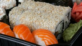 Camera moves left from stylish fresh sushi set with various kinds of sushi rolls, close up. Camera moves left from sStylish fresh sushi set with various kinds of stock footage
