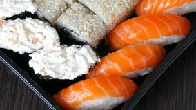 Camera moves right. Great choice Variety of sushi roll, nigiri, maki, Gunkan with salmon, eel, shrimps, Philadelphia. Cheese and other national Japanese cuisine stock video