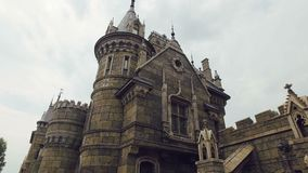 Camera moves to gothic palace with stained-glass windows, bas-reliefs. 4K stock footage