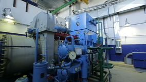 Camera Moves to Powerful Industrial Compressor with Pipes. KAZAN, TATARSTAN/RUSSIA - JUNE 12 2016: Camera moves to powerful industrial compressor with pipes and stock video