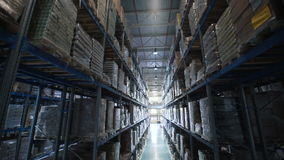 Camera moves up on shelves of cardboard boxes inside a storage warehouse stock video footage