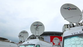 Camera Moves up to Satellite Dish and to Mercedes Minibuses stock footage