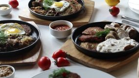 A portrait of various dishes. Camera moving along a table with various dishes stock footage