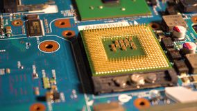 Camera moving over microchip on motherboard stock video footage