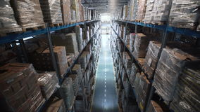 Camera moving between palettes with ordered goods and materials at warehouse stock video footage